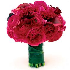 "Love, Luck and Angels  Instead of white blooms, Elizabeth Banks carried a bright bouquet—similar to this one—featuring ranunculus and cockscomb in a bold fuschia hue. ""A vibrant bouquet is a twist on tradition,"" planner Jo Gartin of Love, Luck and Angels has said. ""It's a contrast to the dress and definitely more modern."""