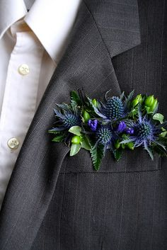 Groom's boutonniere, a floral pocket square with eryngium. The steely blue thistle looks amazing against the charcoal gray pinstripes! Prom Flowers, Wedding Flowers, Floral Wedding, Wedding Bouquets, Button Holes Wedding, Fleur Design, Before Wedding, Wrist Corsage, Groom And Groomsmen