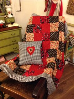 Patchwork blanket and matching cushion.