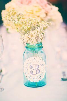 Doily table numbers on mason jars.