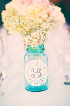 Doily table numbers on mason jars. Photography by threenailsphotography.com