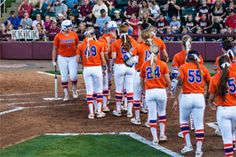 The Gators celebrated as Bailey Castro's two home runs highlighted Wednesday's win. (Photo: Maury Neipris) 4/8/15