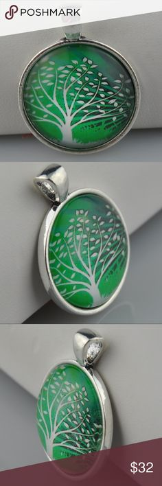 "Green Tree of Life Photo Art Necklace Pendant is 1"" round Image sealed under glass in an antique silver tone tray  Choice of 16"", 18"", 20"", or 24"" Rolo or Ball chain(cut to order), or pendant only  Hand assembled so small air bubbles may be present. Water resistant but not waterproof. Phot taken with quarter for size.   Smoke free pet friendly home.  Internal SKU: GREENTREE Handmade Jewelry Necklaces"