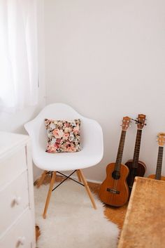 Floral pillow and guitars