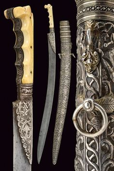An important yatagan : dating: mid-19th Century provenance: Turkey Wide, curved, single-edged blade with Arabic stamp near the forte, the first part of the back carved, the base with silver wings, engraved with floral motifs, silver grip, decorated en suite with carved, anatomic grip scales; fine, wooden scabbard with silver-plated covering finely embossed and engraved with a sailing ship, trophies and floral motifs, the cap decorated with crossed bands. Marked with a stamp