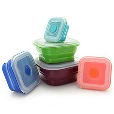 Make life easier when you incorporate this conveniently collapsible set of storage containers from Storable Solutions into your kitchen routine! BPA free silicone is crafted into a collection of square containers that are microwave and freezer safe. They're also oven safe up to 450°F and are color-coded to help you easily identify each size while clear lids allow you to see what's inside without breaking the seal. Plus  each lid features a vent that allows steam to escape during cooking or rehea Storage Sets, Storage Spaces, Food Containers, Storage Containers, Colanders And Strainers, Cutlery Holder, Nesting Bowls, Boutique Shop, Storage Solutions