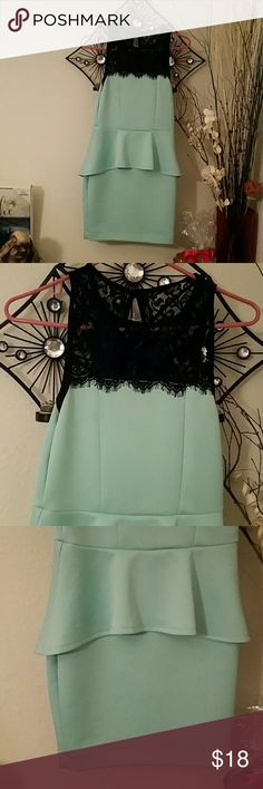 Adorable peplum dress Size medium, Windsor, pastel mint green and black lace peplum mini dress. Very form fitting and button in the back. Excellent condition WINDSOR Dresses Mini