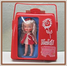 1960's Remco Doll Heidi Pocketbook with Case and Wardrobe - this looks familiar. I think I had one when I was little. I did have one! Heidi and Jan! Hi Heidi/ Hi Jan. she had a button on her back to make her wave.