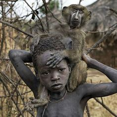 Ethiopian boy & his pet baboon-- you can tell they have a bond.