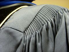 cartridge pleating are used to gather a large amount of fabric into a small waistband or armscye without adding bulk to the seam. This type of pleating also allows the fabric of the skirt or sleeve to spring out from the seam.  Fabric is evenly gathered using two or more lengths of basting stitches, and the top of each pleat is whipstitched onto the waistband or armscye.