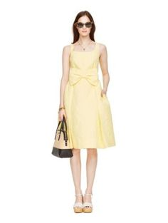 what's up, buttercup? this pretty dress, made from a pale yellow floral jacquard, is perfect for the coming season. (the fit-and-flare cut and oversized bow at the waist are super-flattering, to boot!)