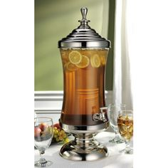 Amazon.com: Godinger Monticello Shannon Crystal Metal and Glass Beverage, Drink, Punch, Dispenser 2.5 Gallon: Home & Kitchen       Mouth blown hand made glass     Nickel plated     Tarnish resistant metal base and lid     Two and a half gallon capacity (9.46 liters)  (Silver-plate that nickel, please!!!)