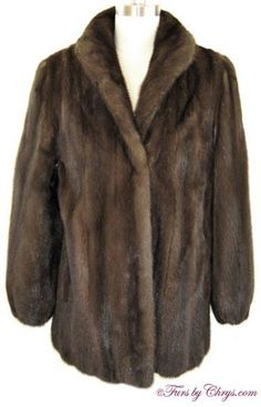 Mahogany Mink Jacket #MM787; $800.00; Excellent Condition; Size range: 6 - 10 Average or Petite. This is a gorgeous genuine natural mahogany mink fur jacket which looks as if it has rarely, if ever, been worn. It has an S. Baum's Furs label and features a small shawl collar, lightly padded shoulders and lightly-elasticized sleeve ends. The mink is very silky soft and the fine workmanship indicates that it is a high-quality mink jacket. This mahogany mink jacket is very versatile.