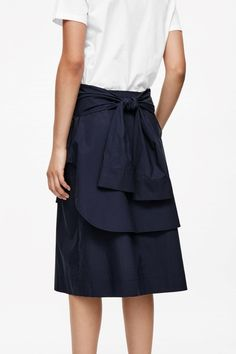 Skirt with shirt details