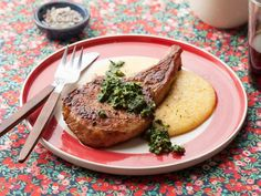 Get Food Network Kitchen's Pork Chops with Roasted Kale and Walnut Pesto Recipe from Food Network
