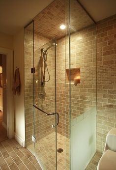 Curb less shower with travertine subway tile