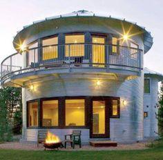 Un-used grain silo turned into a pre-fab home! Via Off The Grid