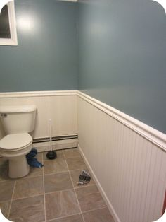 Bathroom wainscoting - could definitely see doing something like this in the bathroom, only taller. Love the blue/gray too
