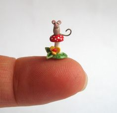 cute polymer clay sculptures, this one is my favorite.  you can see more from this artist by clicking here: http://www.etsy.com/shop/ArtisticSpirit?ref=seller_info