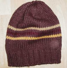 perfect close fitting cap, perfect for a quick knit and a favorite cap. Unisex and easy to make up, good scrap buster. Knitted beanie from a free knitting pattern