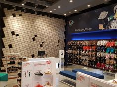 Explore the dynamic nature of movement of shoes as a result of their function and translate the energy, flow and engagement into the retail experience. Use the design of the product displayed as inspiration for color, texture and form. Use the storage/container of shoe boxes as a focal point and make it an interactive part of the retail area.