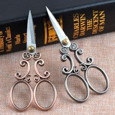 Beautiful ornate Vintage-look stainless steel embroidery scissors. These gorgeous scissors are approximately 13cm x 5.5cm with lovely sharp points perfect for embroidery, cutting material or to have in your knitting and crocheting accessories.  They come in a choice of copper or steel grey as seen in the photos above.  The listing price is for one pair of scissors.  SHIPPING  Thank you for looking and please enjoy your shopping.  SHIPPING NOTE: Items ship from Australia. Orders to overseas…