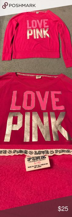 PINK Sweatshirt Worn but in great condition. Very soft. No holes or stains. Graphics on front and back. Very light pulling in armpits, but otherwise great condition. Awesome sweatshirt! Size large. True to size. PINK Victoria's Secret Tops Sweatshirts & Hoodies