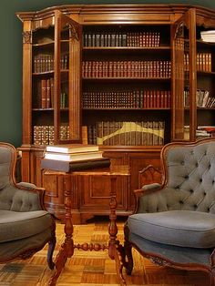 Lovely furniture piece for a home library - love the dark green wall too