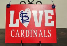 This is our Love StL Cardinals canvas. This canvas is a 11 x 14 painted in red with white vinyl and a blue vinyl StL in the middle of the O.
