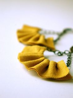 Linen ruffle earrings in mustard yellow. Beautiful linen is threaded and cinched to make a dainty little ruffles with mega texture. Antiqued bronze chain and french ear wires lend these earrings some vintage charm.Earrings measure just over 2 Diy Fabric Jewellery, Fabric Earrings, Fabric Beads, Textile Jewelry, Diy Earrings, Leather Earrings, Earrings Handmade, Handmade Jewelry, Yellow Earrings