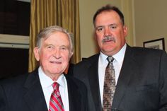 Two Pittsburgh legends -- Former head coach Johnny Majors and former player Russ Grimm.  Both hall of famers.