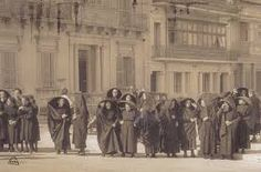 Maltese ladies in their Sunday best. The Ghonnella.