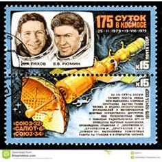 Stamp -- cosmonauts and space station..