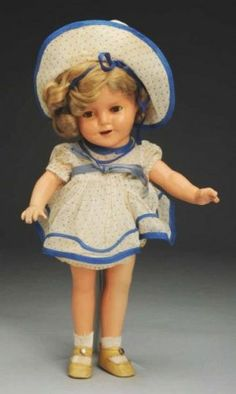 """Ideal Composition """"Shirley Temple"""".Fully marked head and body, smiling face with lashed sleeping eyes, open mouth with tongue and teeth, dimples, original mohair wig in original set; original blue and white polka dot """"Stand Up & Cheer"""" dress with rare matching bonnet, original undies and shoes, replaced socks. Paint color on one hand has faded, cracking on fingers, crazing on back of one leg. Lovely representation in a desirable size with rare bonnet! Size 13"""" T. Z"""