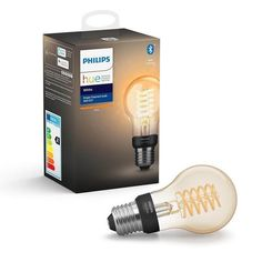 With an elongated design and vintage feel, this Bluetooth-capable LED Edison bulb featuring a coiled filament can make a statement in any room. Use with Bluetooth controls or pair with a Hue Bridge to unlock more smart lighting features. Edison Lampe, Led Lampe, Amazon Echo, Retro Lampe, Smart Lights, Philips Hue, Lighting Setups, Modern Lighting, Dekoration