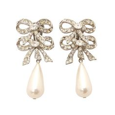 Add a bit of adorable kitschy cuteness to your outfits with these double bow and pearl earrings! Show them off with a cute updo or side ponytail!