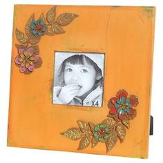 "Wood picture frame with a distressed finish and flower embellishment. Holds one 4"" x 4"" photo.  Product: Picture frameConstruction Material: Wood and glassColor: OrangeFeatures: Fits one 4"" x 4"" pictureDimensions: 9.75"" H x 9.75"" W x 1"" D"