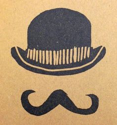 Quite the dapper bowler hat and handlebar mustache. Sketched and carved by Shannon West.