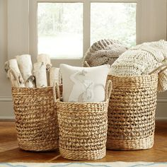Crafted from seagrass and showcasing a woven design, this breezy basket set is perfect for keeping spare towels in the guest suite or toiletries in the master bath.