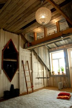 Boho summer cottage - gorgeous fur rug, cute indoor swing & rustic timber.