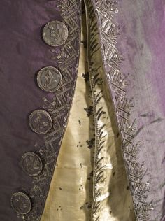 Detail front view, 3-piece suit, Europe, circa 1790, altered circa 1805. Coat and breeches: purple silk plain taffeta with sequins and metallic-thread embroidery; waistcoat: pale yellow silk satin with sequins and metallic-thread embroidery.