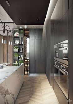 Extraordinary Kitchen Remodeling Planning and Ideas Luxury Kitchens Luxurious modern apartment / KITCHEN. White marble block kitchen island with dark wood cabinetry and thin tall wine display and storage. Love the shelves with storage space too Modern Kitchen Interiors, Luxury Kitchen Design, Best Kitchen Designs, Luxury Kitchens, Interior Design Kitchen, Kitchen Modern, Modern Kitchens With Islands, Contemporary Kitchen Island, Marble Interior