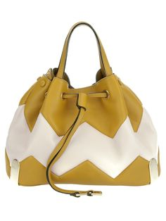 Mustard leather 'Charlie' bag from Chloé featuring a cream zig zag pattern, two top handles, adjustable shoulder strap, detachable gold tone chain zippered purse which sits inside bag and a drawstring closure.