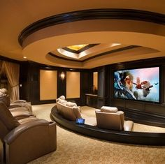 I would love to have a home theater. Maybe not as enormous as this one, but I do like this sort of setup. Not colors, and would probably have dimmer lighting.