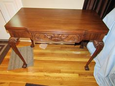 """Vintage Chippendale style flip top table with ball and claw feet, carved knees and sides. In closed position it is 30""""x40""""Wx20.5""""D, in open position it is 41""""D. Minor blemishes noted."""
