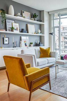 Nord Yarrow Gold Chair - We kept things neutral, with subtle pops of color, to . - Nord Yarrow Gold Chair – We kept things neutral, with subtle pops of color, to keep this small space feeling as big as possi – Home Living Room, Apartment Living, Living Room Furniture, Living Room Shelving, Rustic Furniture, Modern Furniture, Outdoor Furniture, Shelving Decor, Mid Century Living Room