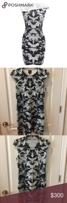 McQ Bird Dress McQ by Alexander McQueen printed bird ink blot dress. It is a beautiful gray-blue in color. Like new! Worn only twice. McQ Alexander McQueen Dresses
