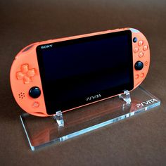 Sony PS Vita 2000 Display Stand / New Console Accessories Games PlayStation Gaming Girl, Ps Vita Games, Portable Console, Color Games, Gamer Room, Retro Video Games, Laser Cut Acrylic, Nintendo Consoles, Sony