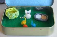 Cat play set in Altoid tin miniature felt toy. via Etsy. Another great idea for shopping, restaurants, etc.!