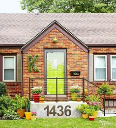 "to Increase Curb Appeal on a Budget I LOVE the giant house numbers, door color and ""hello"" box! What an inviting house! How to Increase Curb Appeal on a Budget – Better Homes & Gardens – Green Front Doors, Front Door Colors, Painted Exterior Doors, Exterior Paint, Better Homes And Gardens, Entry Way Design, Stair Design, House Numbers, Door Numbers"